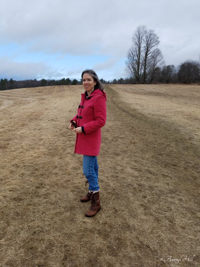 Averyl standing in barren field early spring