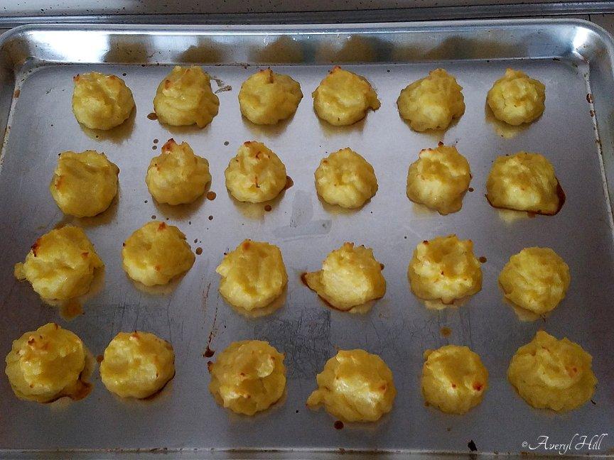 Duchess potatoes on cookie sheet